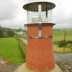 Chimney pot with stainless steel birdguard. This offers weather protection to the chimney flue and prevents animal nesting.